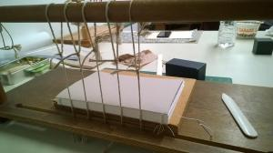 Sewing frame, bookbinding